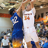 Gallup Bengal Joaquin Ortega (34) is fouled by Bloomfield Bobcat Juan Woody (32) as he takes a shot Friday night at Gallup High School in Gallup. The Bengals took the win 78-56.