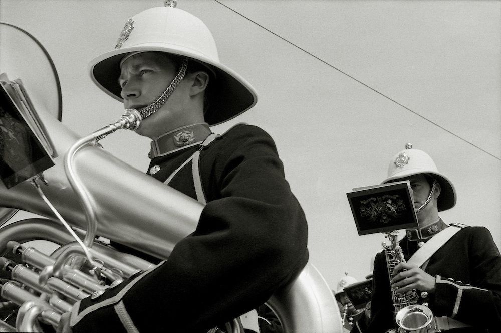 Members of a military marching band take part in a parade in village in Devon. England 1984.<br /> [This photograph is currently licensed through GalleryStock - please contact the photographer for details]