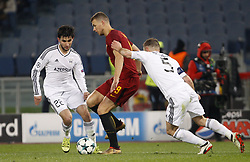December 5, 2017 - Rome, Italy - Roma s Edin Dzeko, left, is challenged by Qarabag s Afran Ismayoilov, left, and Maksim Medvedev, during the Champions League Group C soccer match between Roma and Qarabag at the Olympic stadium. Roma won 1-0 to reach the round of 16. (Credit Image: © Riccardo De Luca/Pacific Press via ZUMA Wire)