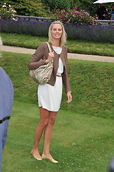 MALIN JEFFERIES at a luncheon hosted by Cartier for their sponsorship of the Style et Luxe part of the Goodwood Festival of Speed at Goodwood House, West Sussex on 1st July 2012.