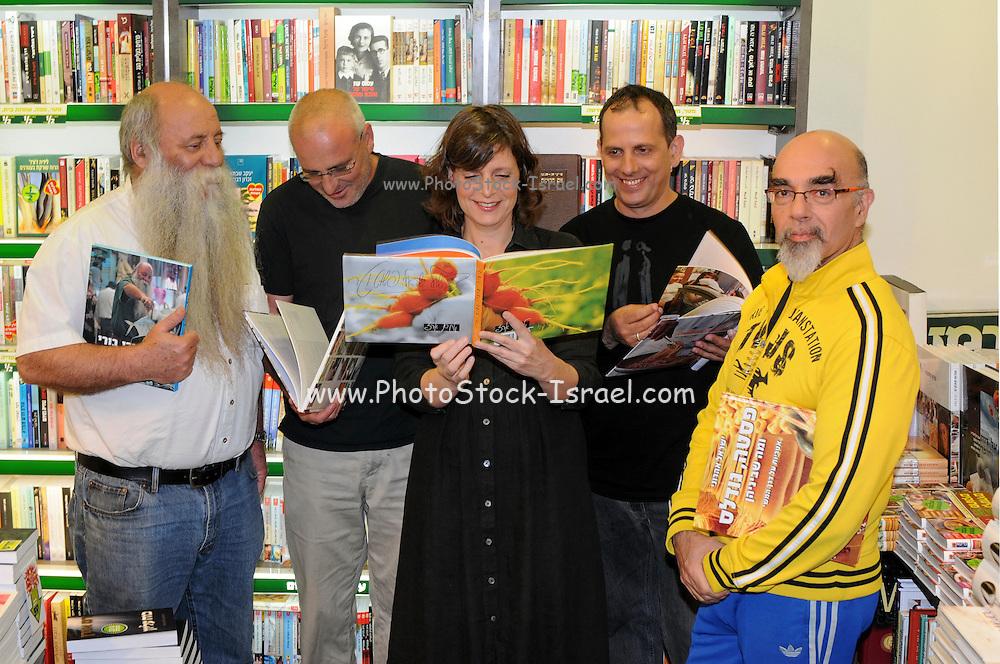 Five top Israeli chefs promote their latest cookbook in a book store (from left to right): Uri Yarmias (AKA Uri Buri), Erez Komarovsky, Orna Agmon, Mane Shtrum, Yisrael Aharoni