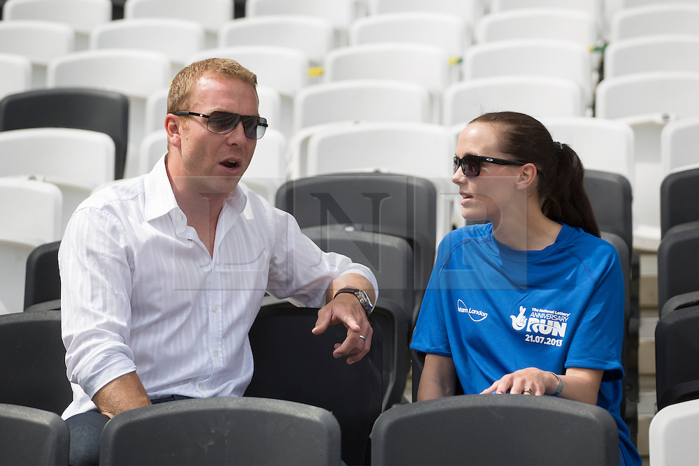 © licensed to London News Pictures. London, UK 21/07/2013. Sir Chris Hoy and Victoria Pendleton at the Stadium at Queen Elizabeth Olympic Park on Sunday, 21 July 2013 to support 12,500 runners of The National Lottery Anniversary Run. The Stadium at Queen Elizabeth Olympic Park open its doors to the public for the first time since London 2012. Photo credit: Tolga Akmen/LNP