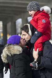 Feb. 09, 2011 - Ottawa, ON, Canada - Liberal MP Justin Trudeau gets a kiss from his wife Sophie Gregoire-Trudeau as he carries his son Xavier, 3, on his shoulder as they skate on the Rideau Canal skateway in Ottawa on Wednesday Feb. 9, 2011.  THE CANADIAN PRESS/Sean Kilpatrick (Credit Image: © The Canadian Press/ZUMAPRESS.com)
