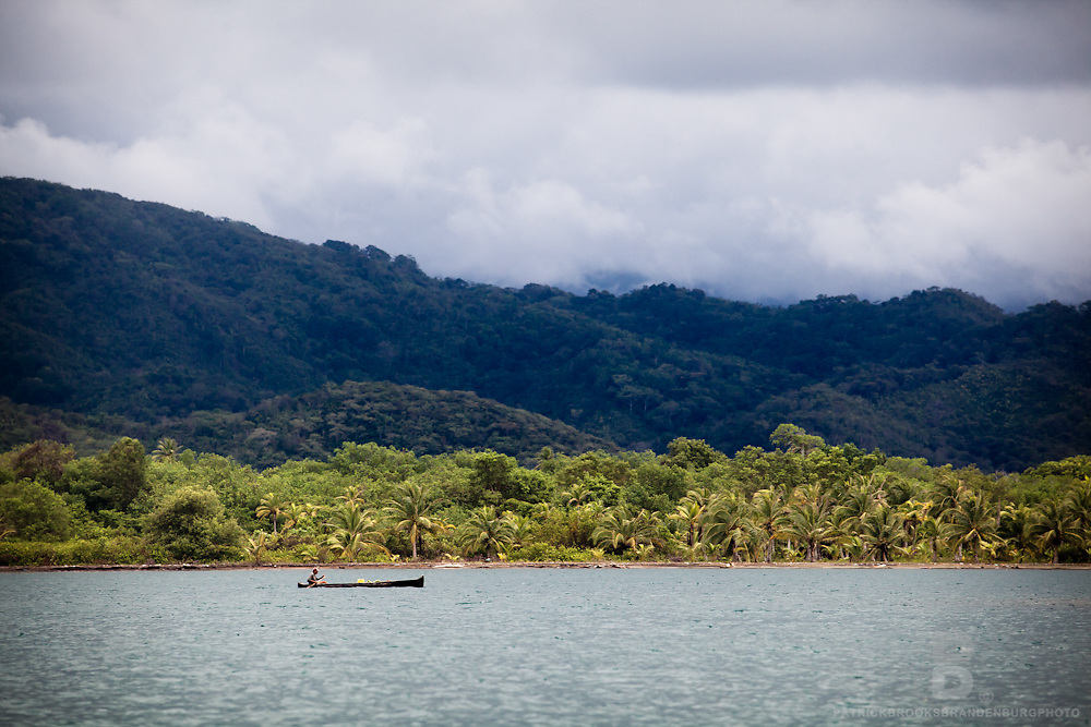 Traditional hollowed out wooden canoes being paddled by the Kuna, an indigenous people of the San Blas Islands.
