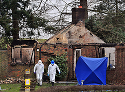 © Licensed to London News Pictures. 26/01/2017<br /> Police investigation continues today as the bodies of a man,woman and a child have been found after a house fire in Trumpets Hill Road, Reigate, Surrey.<br /> Photo credit :Grant Falvey/