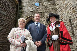 © Licensed to London News Pictures. 26/09/2016. Bristol, UK. Blue Plaque for Gordon Welchman; unveiling of the Blue Plaque by Gordon Welchman's daughter SUSANNA GRIFFITH (left), GCHQ Director ROBERT HANNIGAN, and Bristol Deputy Lord Mayor CHRIS DAVIES, commemorating Gordon Welchman at St Mary's Church, Manor Road, Fishponds, Bristol. Gordon Welchman was born in Fishponds and was recruited to the Government Code and Cypher School (GC&CS) at Bletchley Park. He played an instrumental role in the development of Hut 6 and its famous code-breaking operations during WWII. Photo credit : Simon Chapman/LNP