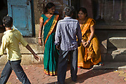 Female sex workers on the street in Kamathipura, which is Mumbai's oldest red-light district and Asia's largest.  It was set up by the British for their troops.