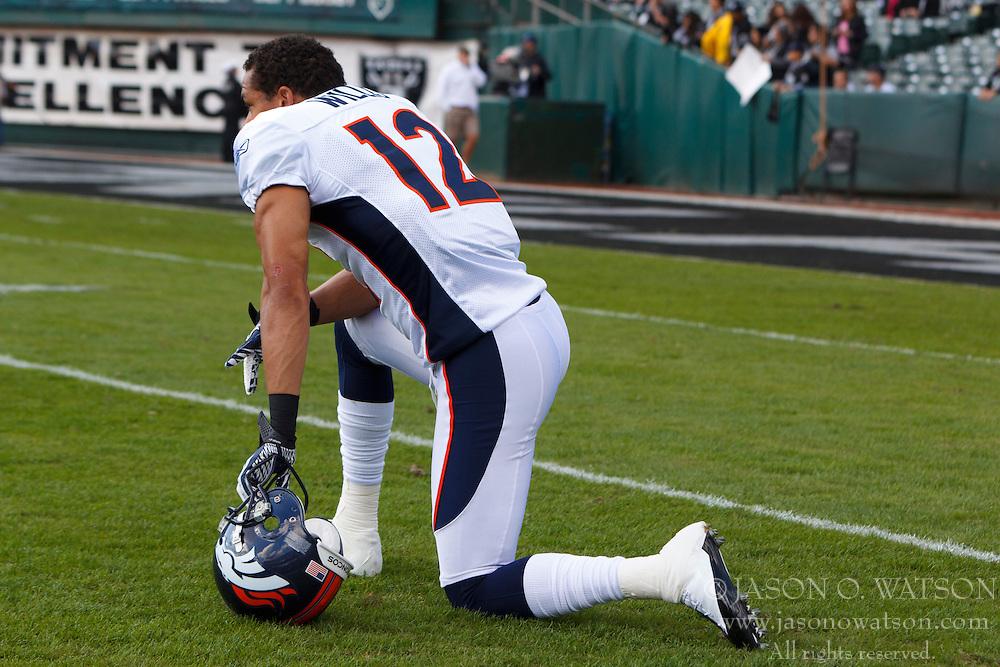 Nov 6, 2011; Oakland, CA, USA; Denver Broncos wide receiver Matt Willis (12) kneels on the field before the game against the Oakland Raiders at O.co Coliseum. Denver defeated Oakland 38-24. Mandatory Credit: Jason O. Watson-US PRESSWIRE