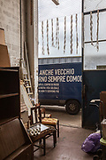 """CAPANNORI, Tuscany, Daccapo warehouse. Daccapo is the place where every kind of  goods are stored . some of them restored and the best pieces are on sale at  the fourniture shop. on the van """" I may be old but I always can be useful"""" Daccapo means """"from skratch"""" """" from the beginning"""""""