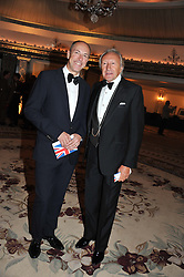 Left to right, DYLAN JONES and HAROLD TILLMAN at Fashion For The Brave held at The Dorchester Hotel, Park Lane, London on 20th September 2012.