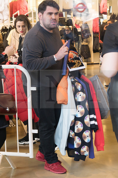 © Licensed to London News Pictures. 08/11/2018. London, UK. A customer with items inside the HM store in Oxford Circus buying the Jeremy Scott H&M X Moschino collection.<br /> Photo credit: Ray Tang/LNP