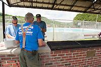 Maurice Chaloux, John Colgrove and Thaddeus Thresher make burger patties in preparation for the 70th Anniversary celebration of the Kiwanis Pool in St. Johnsbury Vermont.  Karen Bobotas / for Kiwanis International
