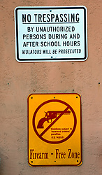 28 January 2015. New Orleans, Louisiana.<br /> Warning signs posted outside the Martin Behrman Charter school in Algiers Point, New Orleans. Once the Martin Behrman High School where Gayle Benson went to school in the late 1950's/early 60's. Gayle Benson is the 3rd and current wife of Louisiana billionaire Tom Benson, owner of the NFL football team The New Orleans Saints and NBA basketball team The New Orleans Pelicans. <br /> Photo; Charlie Varley/varleypix.com