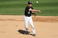 CHICAGO - SEPTEMBER 12:  Omar Vizquel #11 of the Chicago White Sox throws the ball to first base after making a diving grab of a ground ball hit by Lucas May #22 of the Kansas City Royals on September 12, 2010 at U.S. Cellular Field in Chicago, Illinois.  Vizquel got up to throw out May.  The White Sox defeated the Royals 12-6.  (Photo by Ron Vesely)