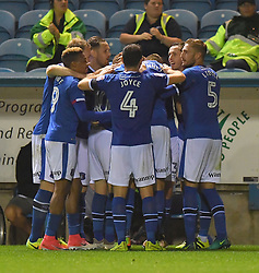 Carlisle United players celebrate their sides first goal of the game scored by Carlisle United's Danny Grainger (hidden)
