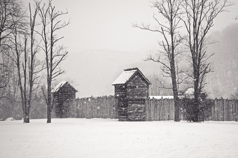 This rustic log fort was built in 1976  as a re-creation of the original Prickett's Fort of 1774, which served as a refuge from Native American war parties on the western frontier of Colonial Virginia.  This was an early afternoon shot of  the Fort; (Fairmont, WV) during a snow storm.