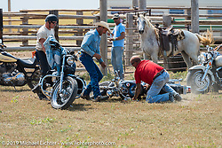 Mike Halachik crashes Hilary Goloda's Sportster in the Spur Creek Ranch rodeo arena on highway 79 north of Sturgis on the Michael Lichter - Sugar Bear ride during the annual Sturgis Black Hills Motorcycle Rally. SD, USA. August 3, 2014.  Photography ©2014 Michael Lichter.