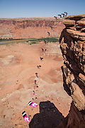 A composite image of Steph Davis B.A.S.E. jumping from a cliff above the Green River in Southern Utah.