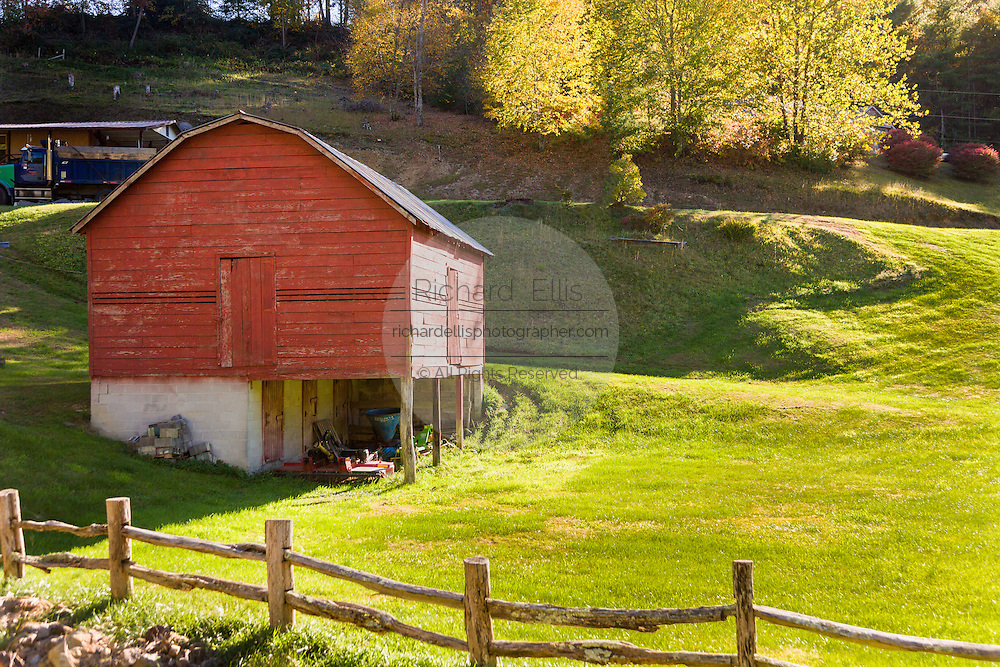 A old wooden barn and split rail fence along the Quilt Trails near Prices Creek, North Carolina. The quilt trails honor handmade quilt designs of the rural Appalachian region.