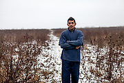 Portrait of Rudo (25) in the field behind the contruction side. The families are living already almost 2 years in their self constructed houses (01/2016). They joined a micro loan program to built themselves their own house. Support by the foundation ETP Slovakia which is working in Rankovce and setting up micro-loan funds for the local Roma community.