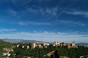 The Alhambra and Sierra Nevada as seen from Mirador de San Nicolás in the Albayzín, Granada (Andalusia), Spain.