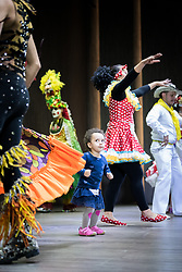 """26 April 2018, Bogotá, Colombia: The Global Christian Forum gathers in Bogotá on 24-27 April 2018 under the theme of """"Let mutual love continue"""". Colombia cultural evening, with Colombian music and dance. Young girl Maya joins the dancers on stage (parental consent obtained)."""