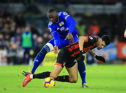Bournemouth's Dominic Solanke (right) and Cardiff City's Sol Bamba battle for the ball during the Premier League match at the Cardiff City Stadium.