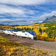 fall colorsand glacier national park, amtrak train,