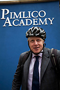 London, UK. Friday 19th October 2012. The Mayor of London, Boris Johnson leaves Pimlico Academy secondary school on his bicycle as he unveils ambitious plans to make London a world leader in education. The announcement coincides with the publication of the final report from the Mayor's Education Inquiry, which the Mayor commissioned to look at the challenges facing London's schools.