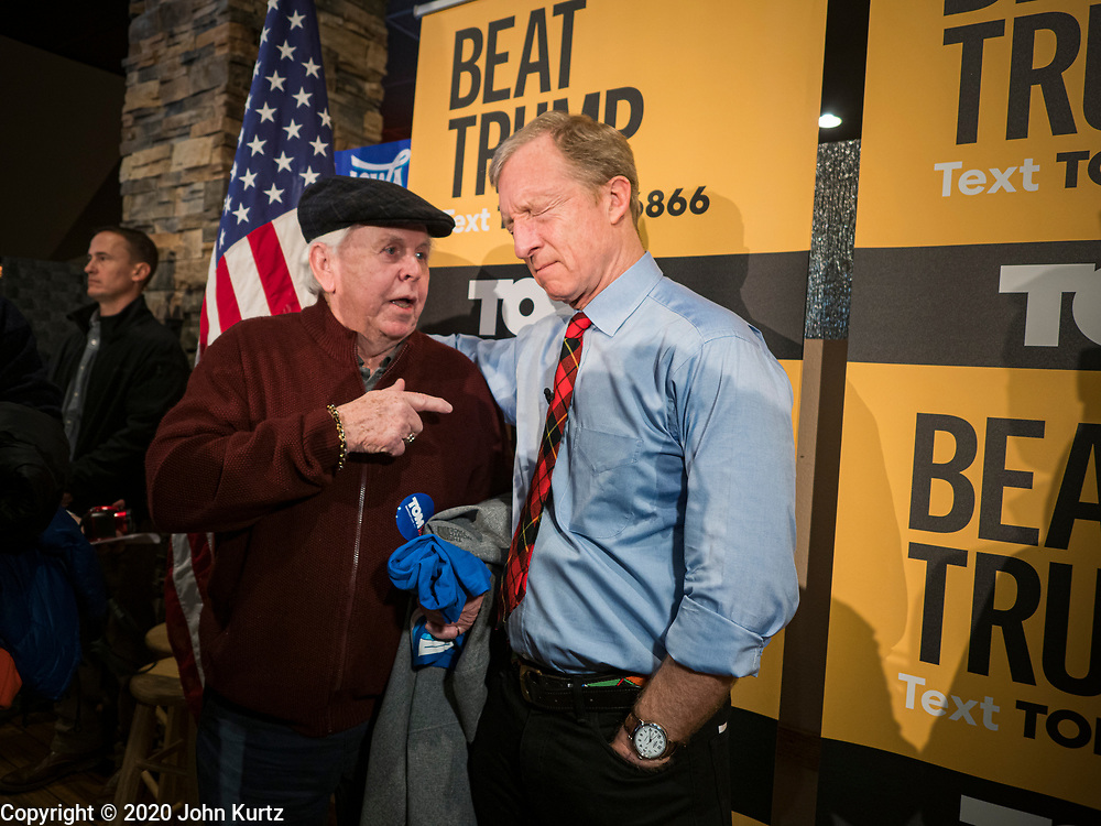 29 JANUARY 2020 - KNOXVILLE, IOWA: TOM STEYER, right, squints while he talks to a person at a campaign event in Knoxville, about 40 miles southeast of Des Moines, Wednesday. About 60 people attended the campaign meet and greet. Steyer, a California businessman, is campaigning to be the Democratic nominee for the US Presidency in 2020. Iowa holds the first selection event of the 2020 election cycle. The Iowa Caucuses are Feb. 3, 2020.         PHOTO BY JACK KURTZ