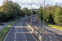 Licensed to London News Pictures. 27/09/2021. Dorking, UK. A very quiet rush hour on the A3 Kingston Bypass south-west London this evening (17:30), a major road in and out of the Capital and usually synonymous with long tailbacks as motorists continue to struggle to find petrol stations with fuel. Large queues have formed at petrol stations across the country over the weekend with many running out of fuel as oil giants struggle to maintain deliveries due to the lack of HGV drivers. Photo credit: Alex Lentati/LNP