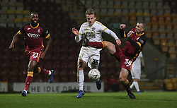Jason Cummings of Peterborough United is challenged by Paul Caddis of Bradford City - Mandatory by-line: Joe Dent/JMP - 11/12/2018 - FOOTBALL - Northern Commercials Stadium - Bradford, England - Bradford City v Peterborough United - Emirates FA Cup second round proper