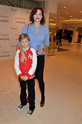 JASMINE GUINNESS and her son OTIS RAINEY at the launch of the 'Jasmine for Jaeger' fashion collection by Jasmine Guinness for fashion label Jaeger held at Fenwick's, Bond Street, London on 9th September 2015.