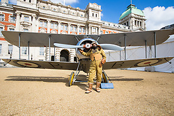 Horseguards Parade, Westminster, March 31st 2016. Dressed in a period flying suit, Education Officer Vernon Creek of the Royal Air Force Museum poses with a 1918 Sopwith Snipe. The Royal Air Force Museum displays three aircraft on Westminster's Horseguard's Parade to promote the forthcoming 100th anniversary of the establishment of the Royal Air Force. The aircraft are a 1918 Sopwith Snipe, a Second World War Spitfire Mk XVI and a modern Eurofighter Typhoon. <br /> ©Paul Davey<br /> FOR LICENCING CONTACT: Paul Davey +44 (0) 7966 016 296 paul@pauldaveycreative.co.uk
