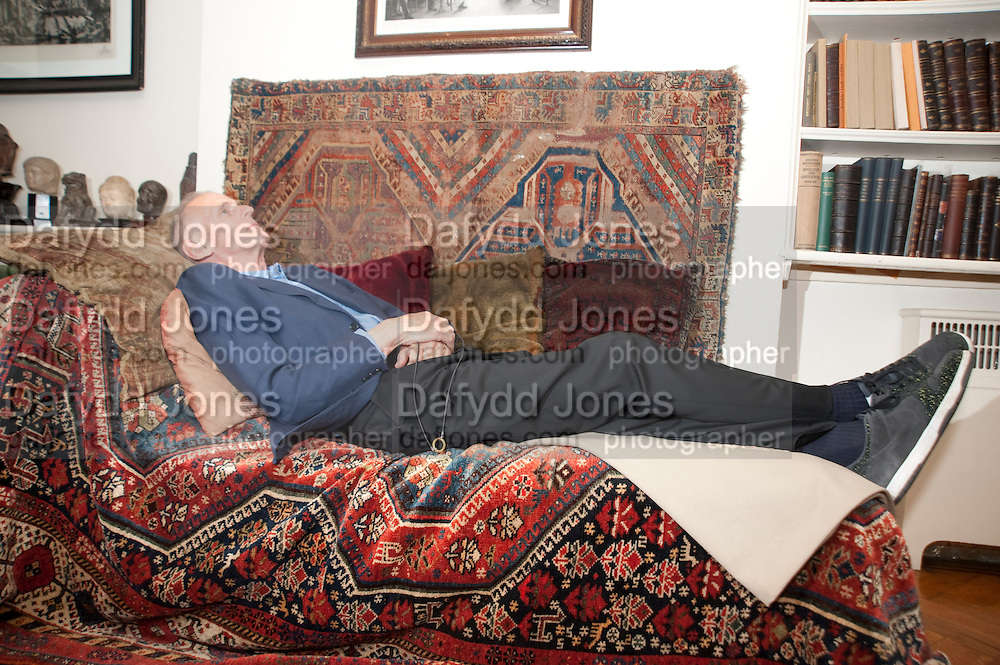 JAMES FOX ON FREUD'S COUCH, Freud Museum dinner, Maresfield Gardens. 16 June 2011. <br /> <br />  , -DO NOT ARCHIVE-© Copyright Photograph by Dafydd Jones. 248 Clapham Rd. London SW9 0PZ. Tel 0207 820 0771. www.dafjones.com.