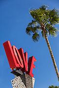 Palm tree and Love sign at Main Street Disney World in Lake Buena Vista, Florida.
