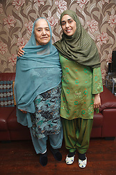South Asian daughter with her mother.