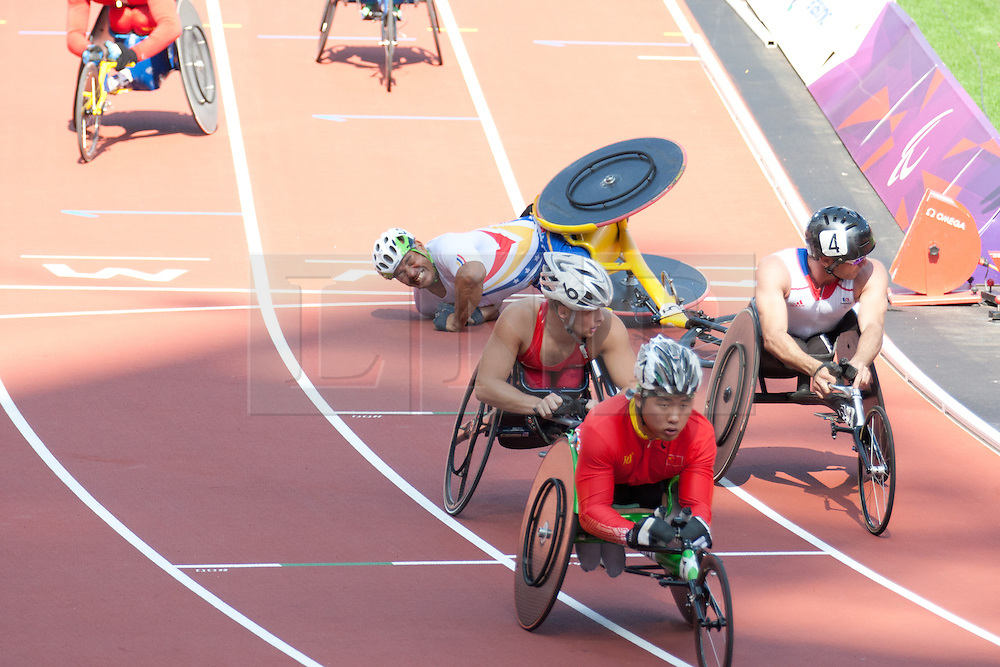 © London News Pictures. 04/09/2012. Venezuelian paralympian - J Aguilar crashes before the finish line when he was competing in the 2nd heat of the Men's T53 800m race. Photo credit should read Manu Palomeque/LNP