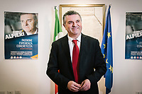 MONTECORICE, ITALY - 14 FEBRUARY 2018: Franco Alfieri (Democratic Party, PD, Partito Democratico), a candidate running for the Chamber of Deptuies in the 2018 Italian General Elections, poses for a portrait before starting his rally in the Council Chamber in Montecorice, Italy, on February 14th 2018.<br /> <br /> Montecorice is part of the electoral college of Agropoli, in the Campania region (southern Italy) in which Franco Alfieri (Democratic Party, PD, Partito Democratico), politically active for the past 30 years, is running agains the 28-years old Alessia d'Alessandro (Five Stars Movement, M5S, Movimento 5 Stelle).<br /> <br /> The 2018 Italian general election is due to be held on 4 March 2018 after the Italian Parliament was dissolved by President Sergio Mattarella on 28 December 2017.<br /> Voters will elect the 630 members of the Chamber of Deputies and the 315 elective members of the Senate of the Republic for the 18th legislature of the Republic of Italy, since 1948.Santa<br /> <br /> The 2018 Italian general election is due to be held on 4 March 2018 after the Italian Parliament was dissolved by President Sergio Mattarella on 28 December 2017.<br /> Voters will elect the 630 members of the Chamber of Deputies and the 315 elective members of the Senate of the Republic for the 18th legislature of the Republic of Italy, since 1948.