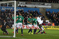 Wilfried Bony of Swansea city (2) shoots and scores his teams 1st goal. Premier league match, Swansea city v West Bromwich Albion at the Liberty Stadium in Swansea, South Wales on Saturday 9th December 2017.<br /> pic by  Andrew Orchard, Andrew Orchard sports photography.
