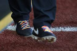 The fourth official wears rainbow laces to show support for the Stonewall Rainbow Laces campaign for LGBT