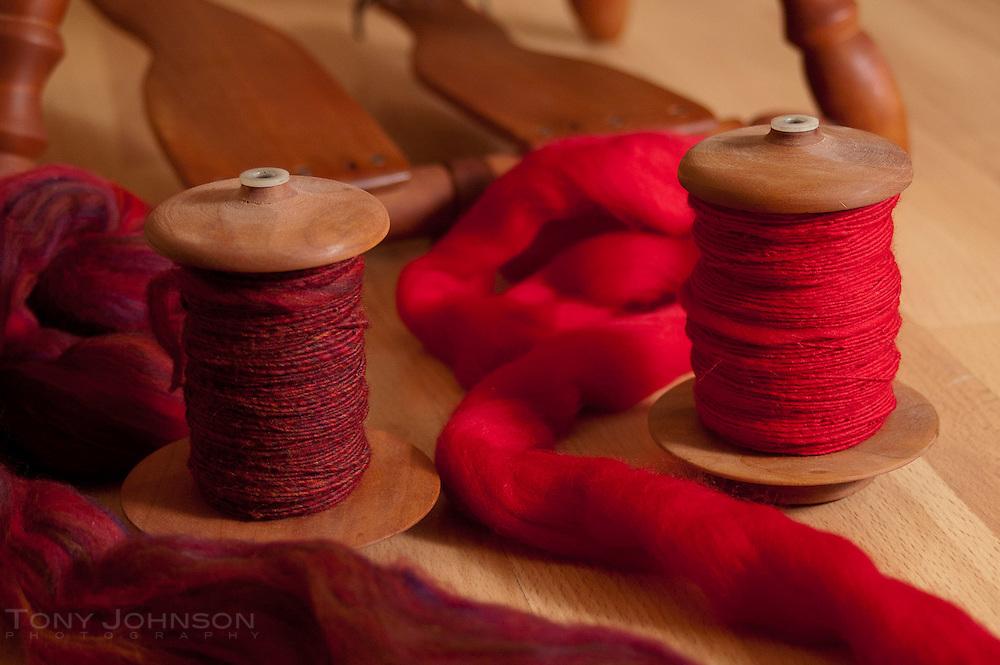 Handspun yarn on bobbins with roving