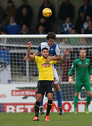 Bristol Rovers' Will Packwood wins a header against Burton Albion's Dominic Knowles- Photo mandatory by-line: Matt Bunn/JMP - Tel: Mobile: 07966 386802 23/11/2013 - SPORT - Football - Burton - Pirelli Stadium - Burton Albion v Bristol Rovers - Sky Bet League Two