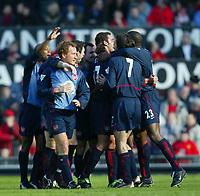 Photo. Aidan Ellis<br />Manchester United v Arsenal. FA Cup Rd 5. 15/02/03<br />Arsenal players celebrate Edu deflected free kick