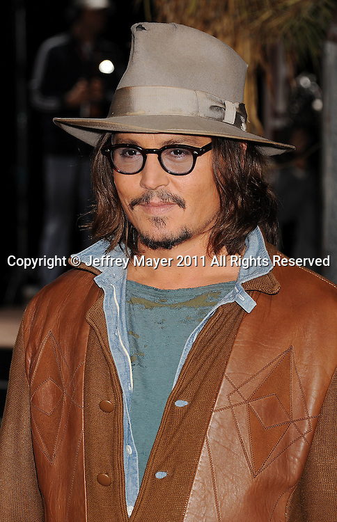 """WESTWOOD, CA - FEBRUARY 14: Johnny Depp arrives at the Los Angeles premiere of """"Rango"""" held at the Regency Village Theatre on February 14, 2011 in Westwood, California."""