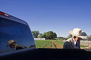 """June 16, 2008 -- COLORADO CITY, AZ: JOSEPH JESSOP, 86 years old, leans against his pickup truck in Colorado City, AZ. Jessop, a polygamist and member of the FLDS, was arrested during the Short Creek Raid in 1953 and had his wives and children taken from him for two years. Colorado City and neighboring town of Hildale, UT, are home to the Fundamentalist Church of Jesus Christ of Latter Day Saints (FLDS) which split from the mainstream Church of Jesus Christ of Latter Day Saints (Mormons) after the Mormons banned plural marriage (polygamy) in 1890 so that Utah could gain statehood into the United States. The FLDS Prophet (leader), Warren Jeffs, has been convicted in Utah of """"rape as an accomplice"""" for arranging the marriage of teenage girl to her cousin and is currently on trial for similar, those less serious, charges in Arizona. After Texas child protection authorities raided the Yearning for Zion Ranch, (the FLDS compound in Eldorado, TX) many members of the FLDS community in Colorado City/Hildale fear either Arizona or Utah authorities could raid their homes in the same way. Older members of the community still remember the Short Creek Raid of 1953 when Arizona authorities using National Guard troops, raided the community, arresting the men and placing women and children in """"protective"""" custody. After two years in foster care, the women and children returned to their homes. After the raid, the FLDS Church eliminated any connection to the """"Short Creek raid"""" by renaming their town Colorado City in Arizona and Hildale in Utah.   Photo by Jack Kurtz"""