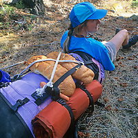 Meredith Wiltsie takes a break during a long hike down a remote Wyoming canyon.