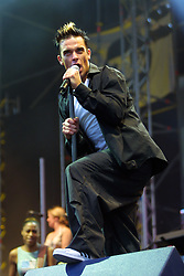 Robbie Williams on stage at Hampden Park in Glasgow, 4th August 2001...
