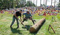 Peter Weeks of Gilford and Richard McMenamon of Moultonboro are timed by AJ Dupere UNH's Woodsman Team coach as they compete in the log roll event at the 2012 Bicentennial Woodsman Competition on Sunday.  (Karen Bobotas/for the Laconia Daily Sun)