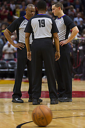 January 7, 2018 - Miami, FL, USA - Referees Michael Smith (38), James Capers (19) and JB DeRosa (62) talk during a timeout between the Miami Heat and Utah Jazz in the fourth quarter on Sunday, Jan. 7, 2018 at the AmericanAirlines Arena in Miami, Fla. (Credit Image: © Matias J. Ocner/TNS via ZUMA Wire)